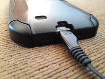 Charging smartphone. Charging the smartphone Royalty Free Stock Images