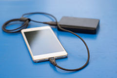 Charging smartphone Stock Image