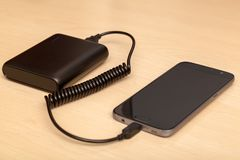 Charging smartphone with a power bank Royalty Free Stock Photography