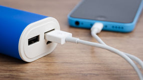 Charging a smartphone from powerbank Royalty Free Stock Images
