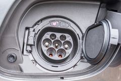 Charging socket of a car with electric drive stock photography