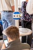 Charging station being used by passengers in an airport Stock Images