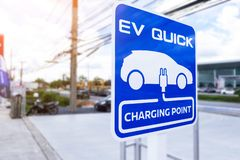 Charging station for electric vehicle.outdoor car parking . blue sign EV quick charging point.  stock photos