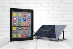 Charging tablet. Tablet pc charging with solar pannel Royalty Free Stock Photo
