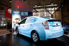 Charging a Toyota Prius at the auto show Royalty Free Stock Photo