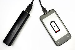 Charging your cellphone with power bank, isolated Stock Image