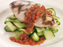 Chargrilled Chicken Breast with Courgette Ribbons. And Tomato Concasse Royalty Free Stock Photos