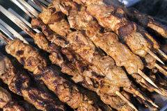 Chargrilled chicken on wooden skewers Royalty Free Stock Images