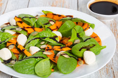 Chargrilled pumpkin, mini mozzarella and spinach autumn salad Royalty Free Stock Photos