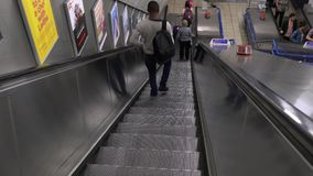 Charing Cross Underground station descending escalator stock footage