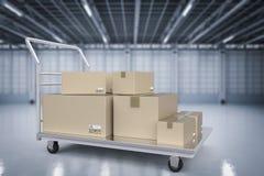 Chariot à entrepôt avec le tas des boîtes de rangement Image libre de droits