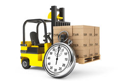 Chariot élévateur avec les boîtes et le chronomètre Images libres de droits
