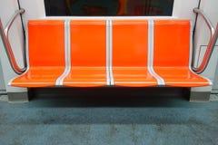 Chariot au fond de sièges vides Images libres de droits