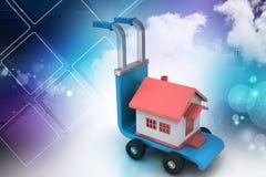 Chariot avec la maison Image stock