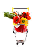 Chariot et légumes à achats Photo stock