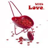 Chariot rouge avec des coeurs sur le blanc Image libre de droits