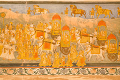 Chariots, the crowd of people and animals on the mural of Mehrangarh Fort, India Royalty Free Stock Photos