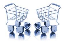 Chariots miniatures à achats Photographie stock libre de droits