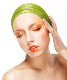 Charisma. Beautiful Woman in Light Green Bandana. Creative Glossy Makeup Royalty Free Stock Image