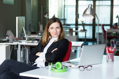 Charismatic Business Lady in official clothing in contemporary Office Interior Royalty Free Stock Image