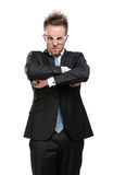 Charismatic business man in glasses with arms crossed Stock Image
