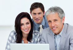 Charismatic business people working at a computer Royalty Free Stock Photos