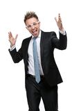 Charismatic businessman in glasses with hands up Royalty Free Stock Image