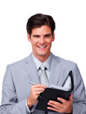 Charismatic businessman holding an agenda Royalty Free Stock Photo