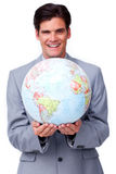 Charismatic businessman holding a globe Royalty Free Stock Photos