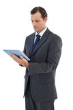 Charismatic businessman holding a tablet pc Stock Photos