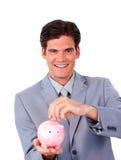 Charismatic businessman saving money Stock Photos