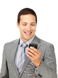 Charismatic businessman sending a text Royalty Free Stock Photography
