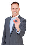 Charismatic businessman showing OK sign Stock Photos