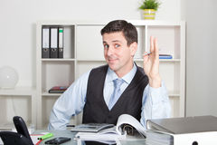Charismatic businessman smiling at the camera Stock Images
