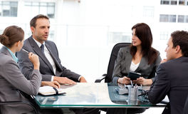 Charismatic businessman talking to his partners Royalty Free Stock Photo