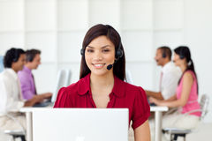 Charismatic Businesswoman with headset on. At work Royalty Free Stock Images
