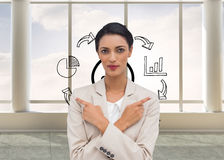 Charismatic businesswoman with her arms crossed and fingers pointing Stock Image