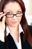Charismatic businesswoman holding her glasses Royalty Free Stock Photos
