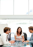 Charismatic businesswoman talking to her team Stock Images