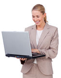 Charismatic businesswoman using a laptop Stock Photography