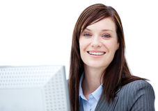 Charismatic businesswoman working at a computer Royalty Free Stock Images
