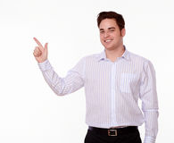 Charismatic caucasian man standing and pointing Stock Photography