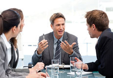 Charismatic chairman talking with his team Stock Images