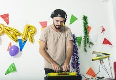 Charismatic disc jockey DJ music players having fun party. In the night. celebration happy new year and christmas stock photos