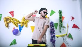 Charismatic disc jockey DJ music players having fun party. In the night. celebration happy new year and christmas stock photography