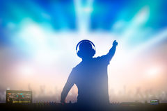 Charismatic disc jockey at the turntable. Charismatic disc jockey. Club, disco DJ playing and mixing music for crowd people Stock Photo