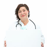 Charismatic doctor holding blank board. Smiling friendly charismatic doctor or nurse with a stethoscope holding blank board for your text or advertisement Stock Photos