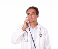 Charismatic doctor holding a phone conversation Stock Photo