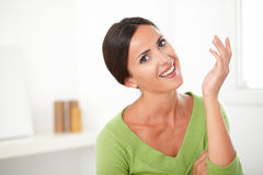 Charismatic elegant woman smiling with sincerity Royalty Free Stock Photo