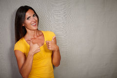 Charismatic female congratulating with fingers up Stock Photography